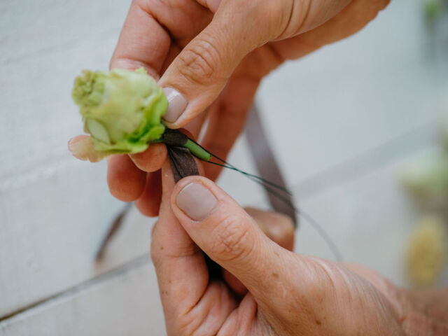 Susan McLeary demonstrates how to wire a flower stem a rosebud stem using the piercing method