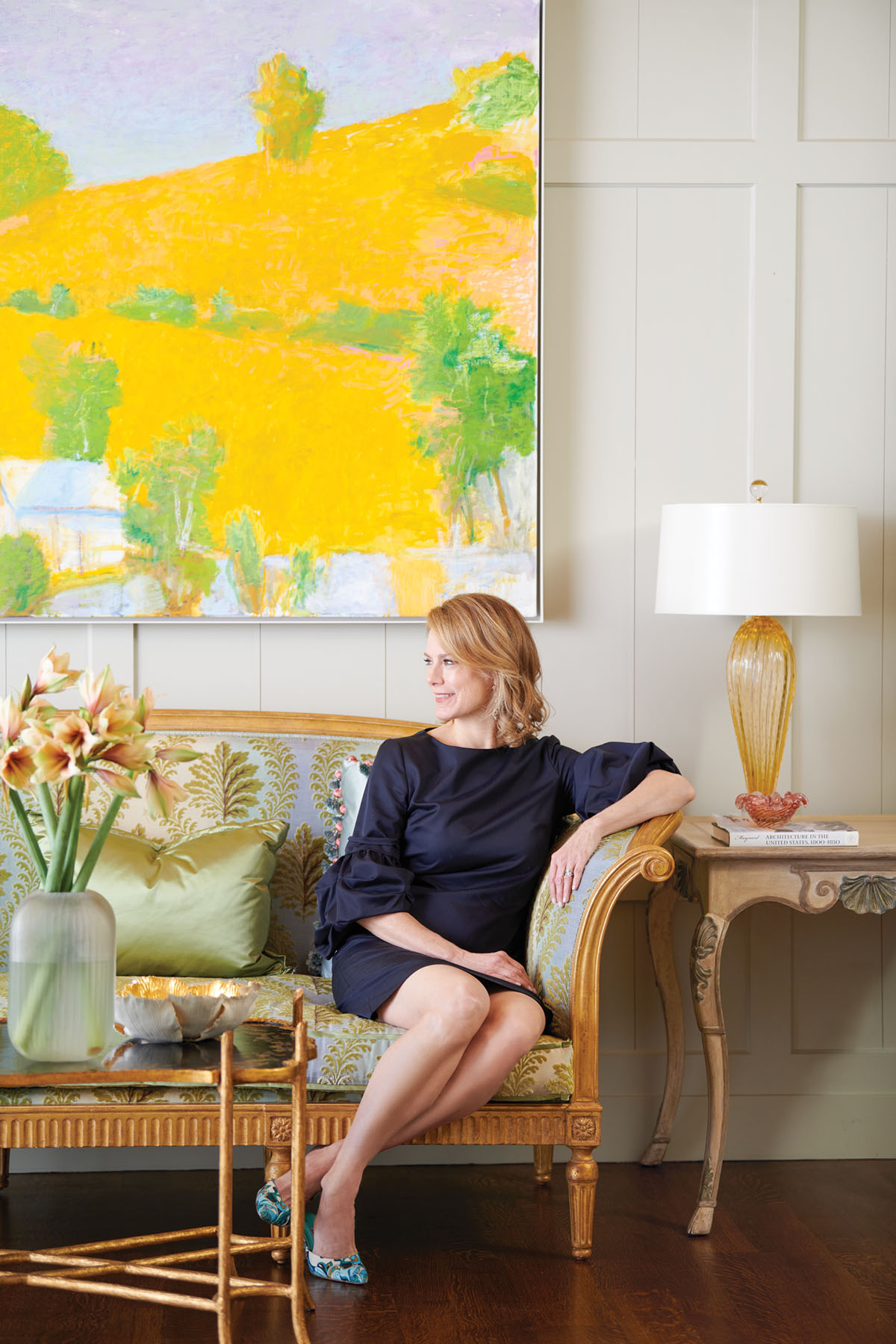 portrait of Fort Worth, TX interior designer Trish Sheats wearing a navy knee-length dress with 3/4 sleeves