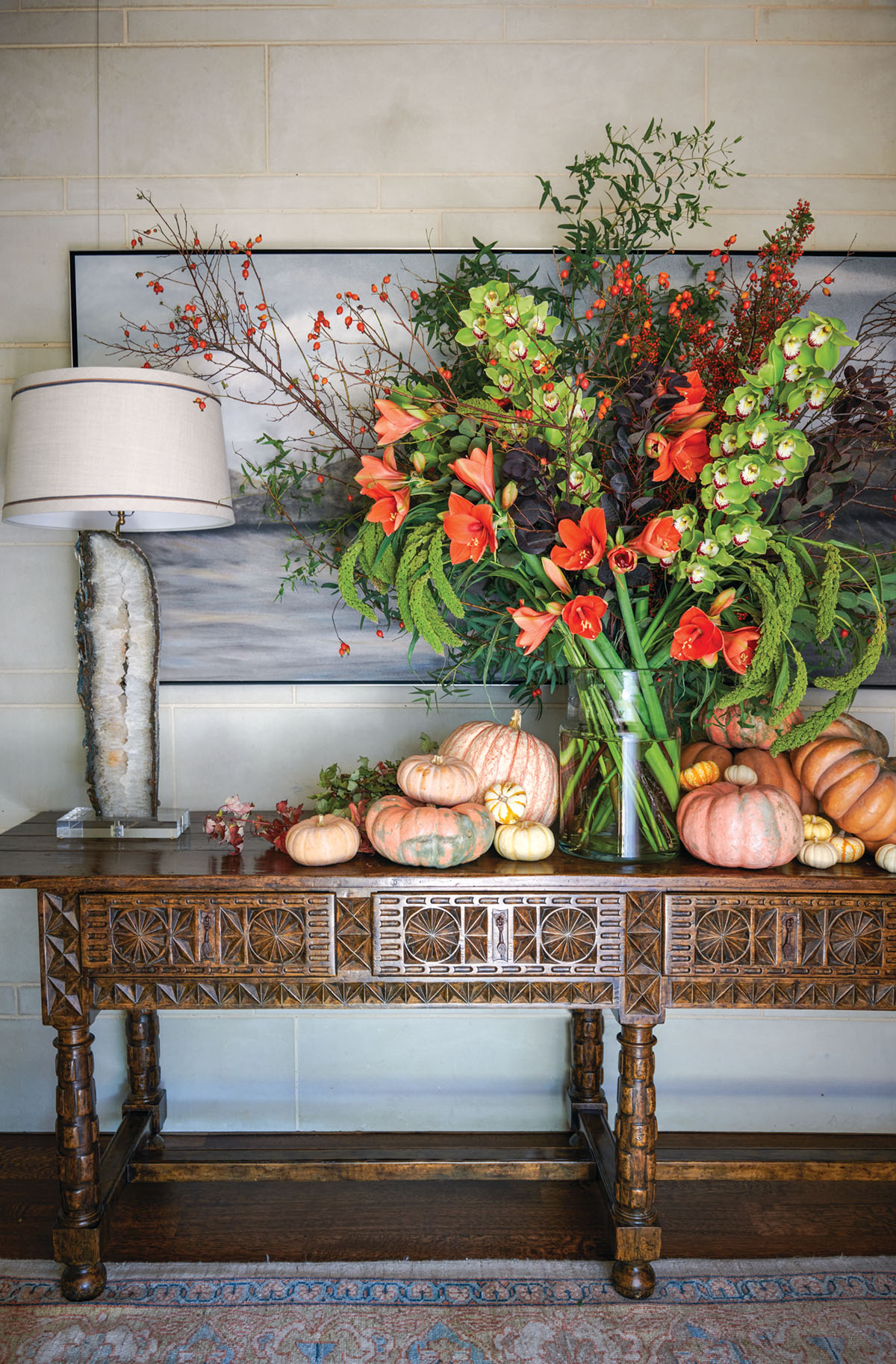 console table with a grand autumn floral display with pumpkins