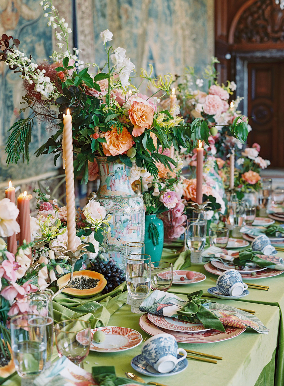 Lush floral arrangements in antique Asian vases line a table set at the Andersen House. Creative direction by Lustre Theory
